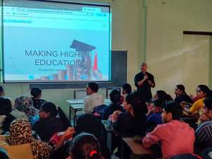 Glossaread team interacting with students at a college